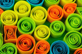 Colorful quilling on blue background close-up — Stock Photo