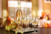 White wine in glass and bottle on room background — Stock Photo