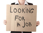 Businesswoman holding sign Looking — Stock Photo