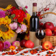 Stock Photo: Colorful autumn still life with apples and and wine close-up