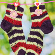 Royalty-Free Stock Photo: Pair of knit striped socks hanging to dry