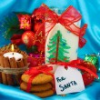 Cookies for Santa: Conceptual image of ginger cookies, milk and christmas decoration on blue background — Stock Photo #16930535