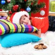 Little boy in Santa hat with milk and cookies for Santa Claus — Stock Photo #16930667