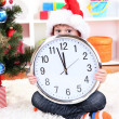 Foto de Stock  : Child with clock in anticipation of New Year
