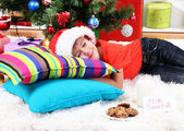 Little boy in Santa hat with milk and cookies for Santa Claus — Stock Photo
