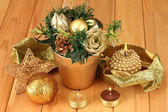 Christmas composition with candles and decorations on wooden background — Стоковое фото