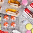 Capsules and pills packed in blisters close-up background — Stock Photo