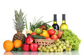 Composition with vegetables and fruits in wicker basket isolated on white — Stock Photo