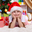 Stock Photo: Little girl near Christmas tree in festively decorated room