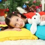 Little girl sleeping near christmas tree — Stock Photo #16950529