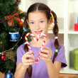 Little girl decorating christmas tree — Stok Fotoğraf #16950569