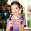 Little girl decorating christmas tree - Stock Photo