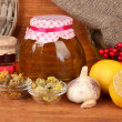 Honey and others natural medicine for winter flue, on wooden background — Stock Photo #16951005