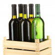 Wine bottles in wooden box isolated on white — Stock Photo #16951795