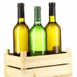 Wine bottles in wooden box isolated on white — Stock Photo #16951805