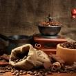Coffee grinder, turk and cup of coffee on burlap background — Stockfoto