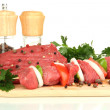 Raw beef meat marinated with herbs and spices isolated on white — Stock Photo #16952021