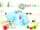 Young female scientist in laboratory — ストック写真