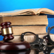 Royalty-Free Stock Photo: Gavel, handcuffs andbook on law on blue background