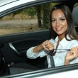 Beautiful young woman in car — Stock Photo #16988255