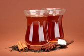 Glasses of Turkish tea, on brown background — Stock Photo