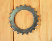 Metal cogwheel on wooden background — Stock Photo