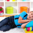 Little boy sleeping under Christmas Tree waiting for Santa Claus to come — Stock Photo