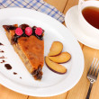 Stock Photo: Tasty pie on plate on wooden table