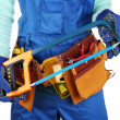 Stock Photo: Male builder in blue overalls with saw isolated on white