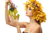 Beautiful young woman with yellow autumn wreath, isolated on white — Stock fotografie