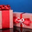 Colorful red gifts on blue background — Stock Photo