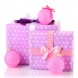 Colorful purple in peas gifts with pink Christmas balls isolated on white — Stock Photo #17181343