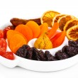 Dried fruits on plate isolated on white — Stock Photo