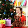 Little girl with large gift box near christmas tree — Stock Photo #17183231