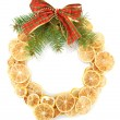 Christmas wreath of dried lemons with fir tree and bow isolated on white — Stock Photo