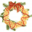 Christmas wreath of dried lemons with fir tree and bow isolated on white — Stock fotografie