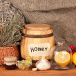 Honey and others natural medicine for winter flue, on wooden background — Stock Photo