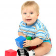 Little boy playing with multicolor blocks — Stock Photo #17186585