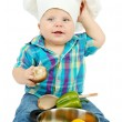 Little boy in chef's hat with pan and vegetables, isolated on white — Stock Photo #17186601