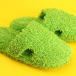 Bright slippers, on yellow background — Stock Photo