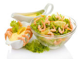 Salad with shrimps, lemon and lettuce leaves in bowl and sauce, isolated on white — Stock Photo