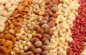 Assortment of tasty nuts, close up — Stock Photo