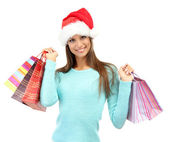 Beautiful young woman with shopping bags, isolated on white — Stock Photo