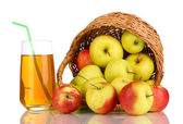 Useful apple juice with apples around in basket isolated on white — Stock Photo