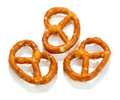 Tasty pretzels isolated on white — Stock Photo