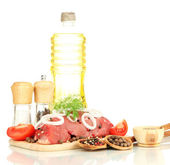 Raw beef meat marinated with herbs, spices and cooking oil isolated on white — Stock Photo