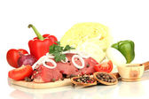 Raw beef meat with vegetables isolated on white — Stock Photo