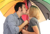 Loving couple with umbrella isolated on white — Стоковое фото