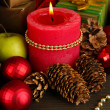 Composition from Christmas decorations close-up on wooden table on wooden background — Stock Photo