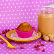 Delicious peanut butter with cake on purple background with polka dots — Stock Photo